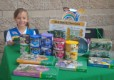Girl Scout Daisy Jenna from Troop 6509 in Foothill Ranch greets customers with a smile