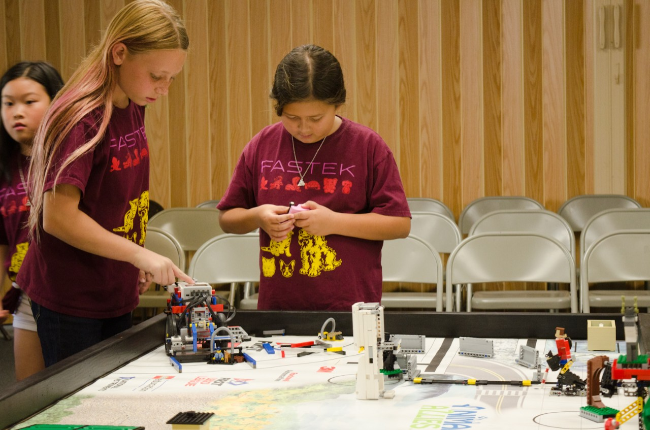 FASTEK - Left to right Girl Scouts Kim Hoang, Sofia Giambone, Ella Duey practice at mock tournament