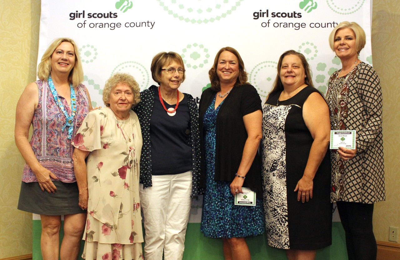 Nancy Moses (third from left) receives 25 Year Pin with fellow volunteers at the 2016 Girl Scout Recognition Event